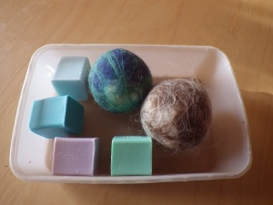 Woolly wash balls (left merino, right Shetland wool) and their little soap 'hearts'