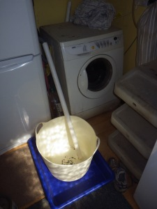 A length of rigid pipe and a large container were all that was required to collect water from the washing machine.