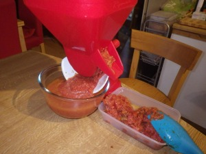 ... passata (in the bowl) and skin + seeds (in the tray) out