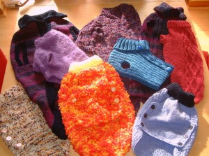 A charitable donation: coats I knitted to support a dog rescue centre