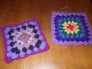 My first two squares: the one on the left represents my yarn ethics design; the one on the right came out of a bag of yarn from Freecycle and so represents the permaculture principle 'produce no waste'.
