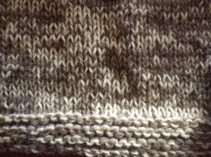 Light grey and cream strands knitted together for warmth and a nice mottled effect