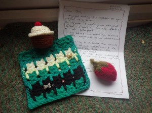 A catty square, plus a strawberry and a cupcake!