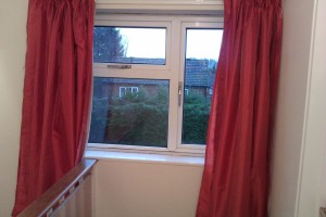 The shortened curtains also in place
