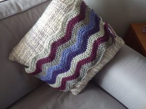 Testing out the colours of the cushion in situ at an early stage of creation