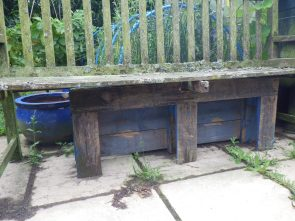 Bench mended with an old pallet