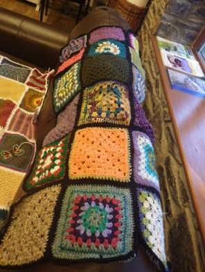 The squares have been made by lots of people, but Lindsey has edged and stitched all of them together