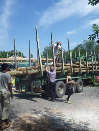 The logs for the roof arrive