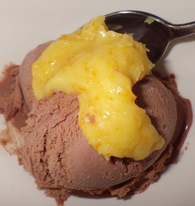 Homemade chocolate ice cream topped with homemade orange curd