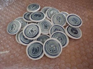 Ceramic buttons... with a tiny leaf motif in the middle of each