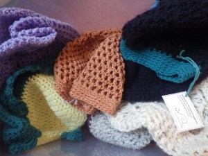 A whole heap of hats in a whole heap of yarns