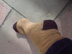 Sock in British Merino (colour 'prize-winning pumpkin') and commercial sock yarn for heel and toe